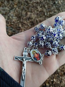 Blue and silver rosary with Sacred Heart medal.