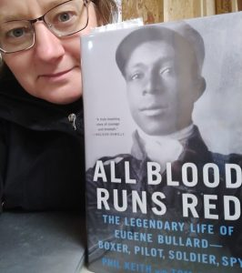 Me with a copy of All Blood Runs Red, a biography of Eugene Ballard by Phil Keith and Tom Clavin