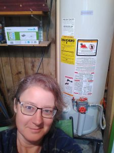 Me posing next to the water heater